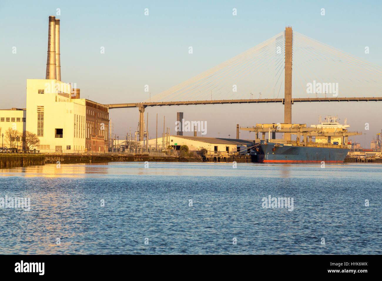 Savannah, Georgia.  Cargo Ship in Savannah River, Talmadge Bridge in Background. - Stock Image