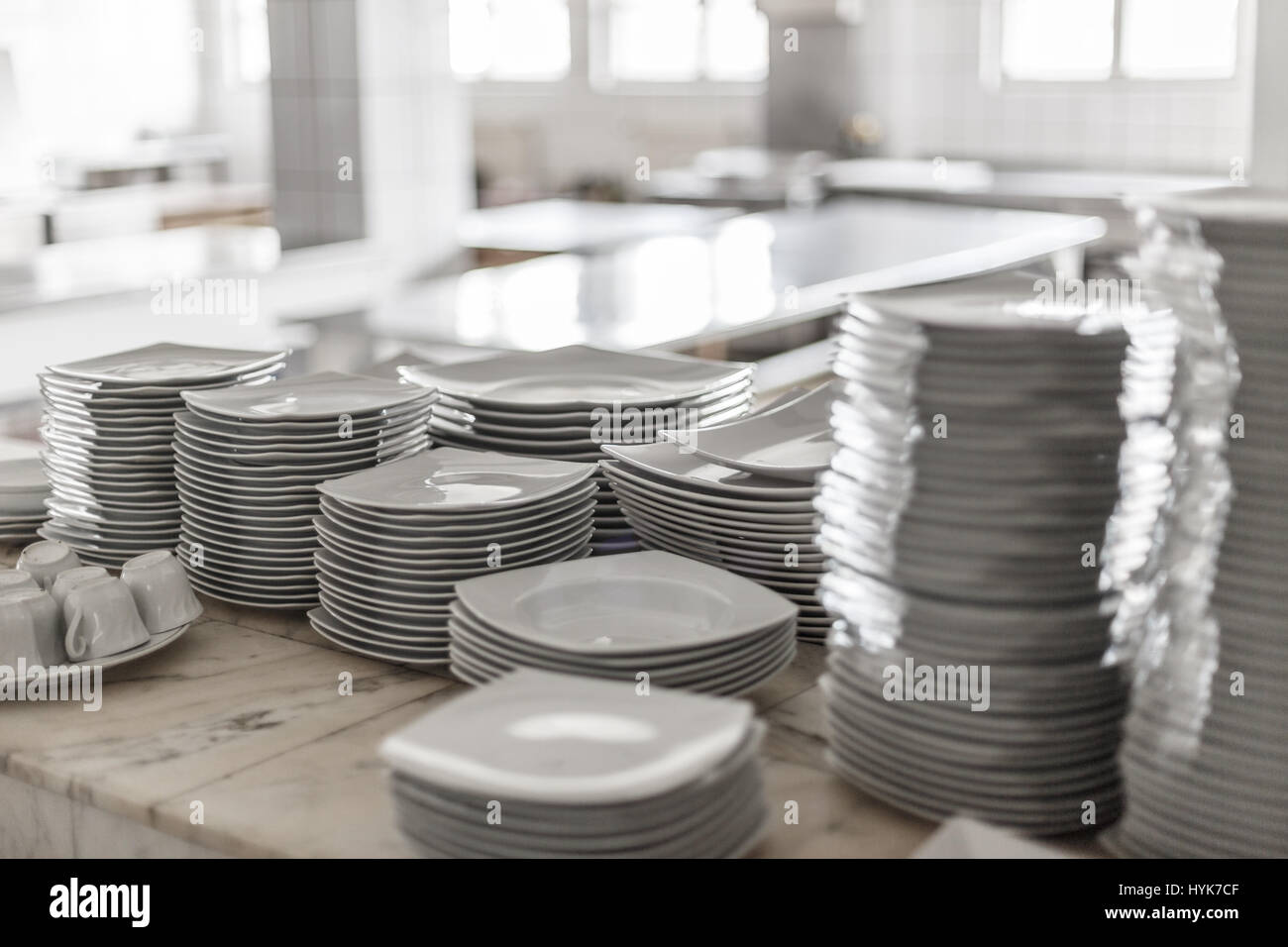 White Empty Clean Dishes On The Restaurant Kitchen Table