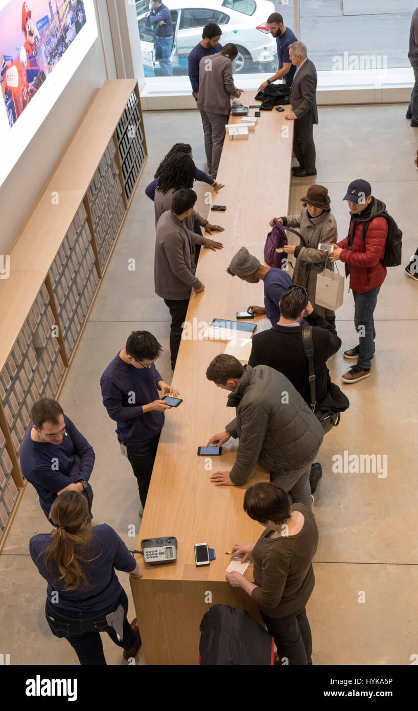 Customers at the Apple Store, Fifth Avenue, New York City, USA Stock Photo