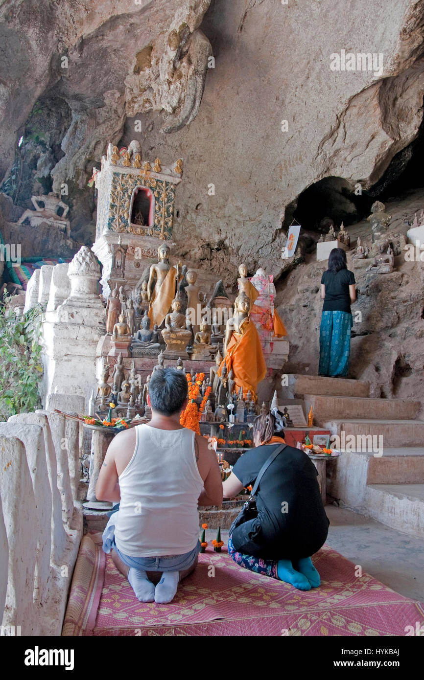 Pak Ou Buddhist Caves on Mekong River north of Luang Prabang are filled with images of Buddha. Stock Photo