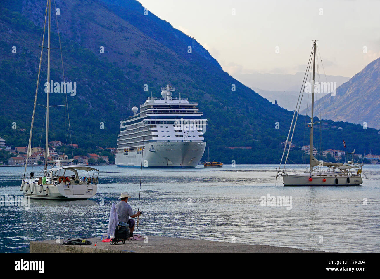 Bay of Kotor harbour with cruise ship in port Stock Photo
