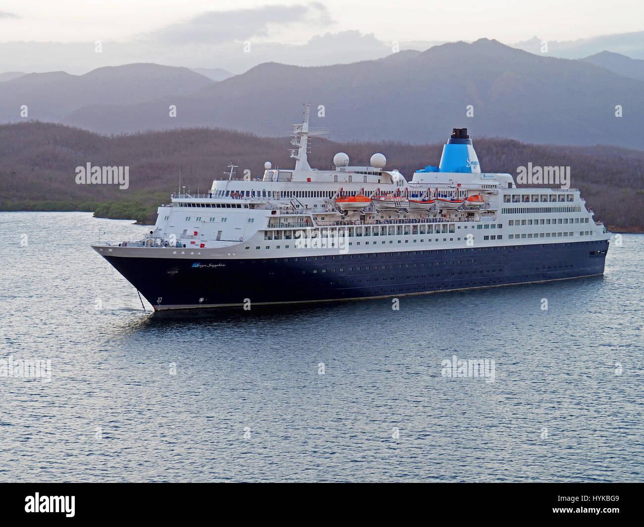 Saga Sapphire cruise ship in harbor of Santaigo de Cuba. - Stock Image