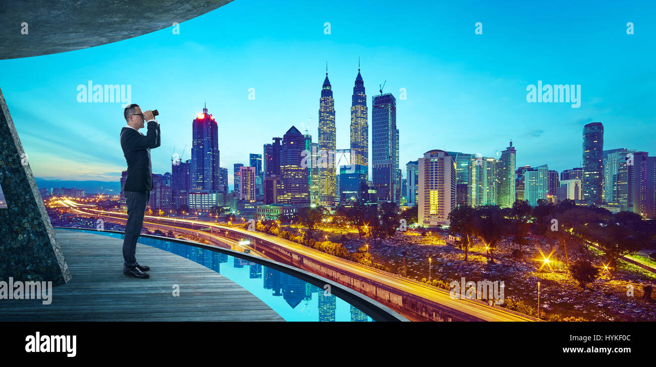 Business Man use the telescope to watch the modern city skyline ,is about looking forward for search key success - Stock Image