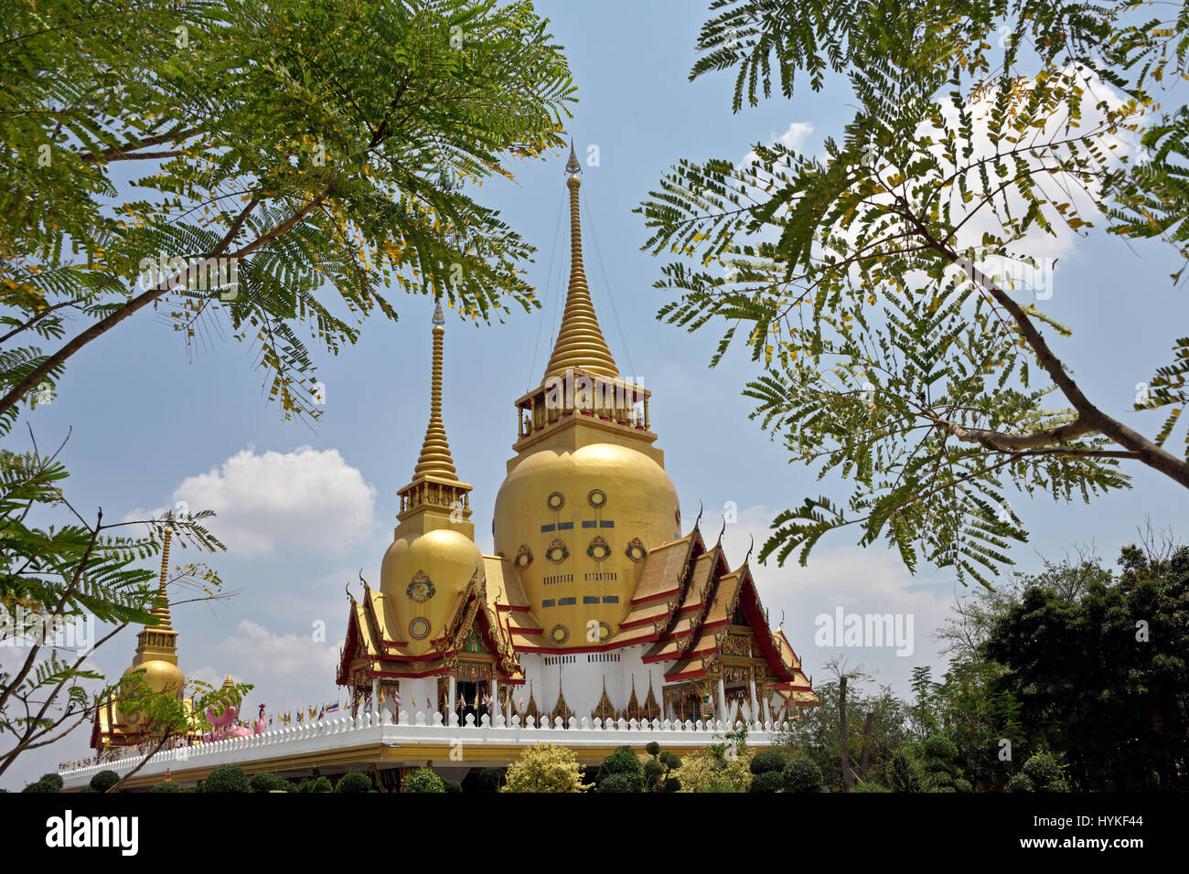 The beautiful golden ubolsot of Wat Phrong Akat in Bang Nam Phriao District in Central Thailand - Stock Image