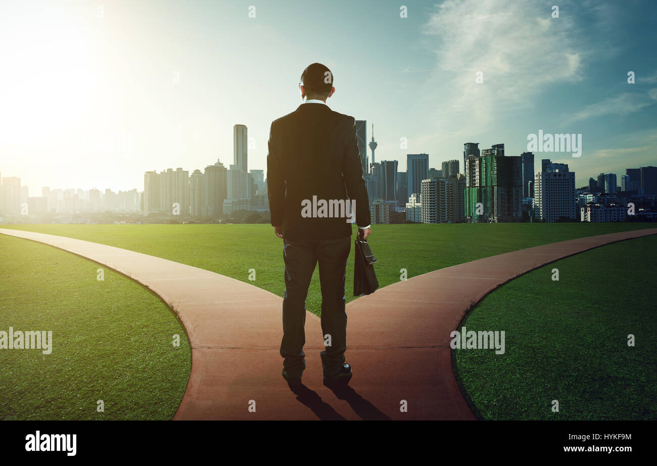indecisive man and lost chooses the right path - Stock Image
