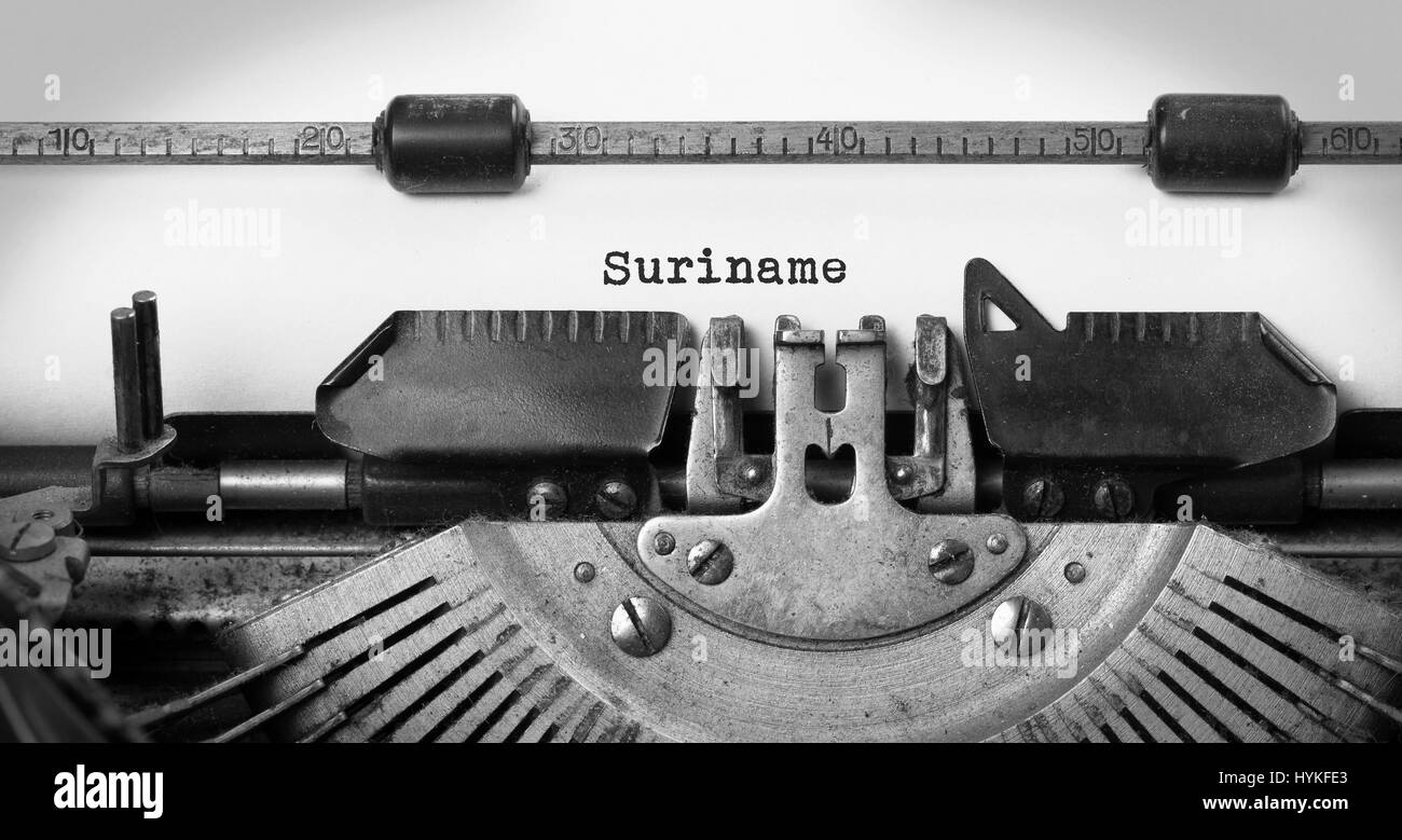 Inscription made by vintage typewriter, country, Suriname - Stock Image