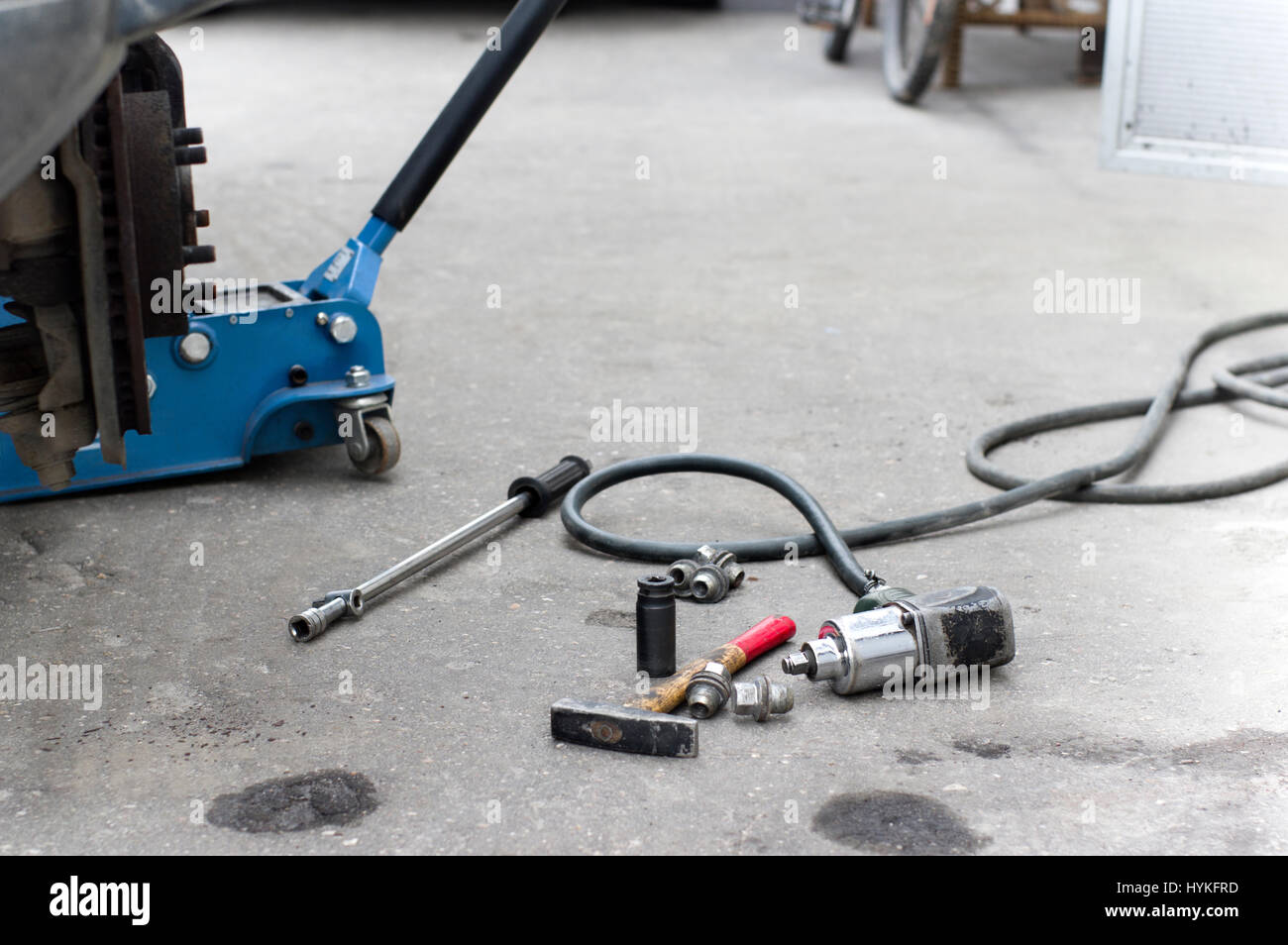 Sensational A Lift Jack Under A Car And Work Tools Spread Out On The Home Remodeling Inspirations Basidirectenergyitoicom