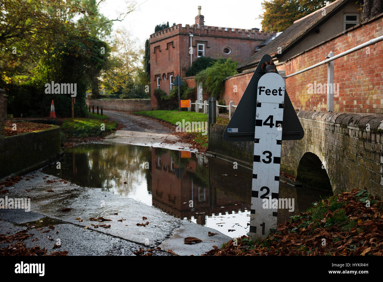 Ford crossing a road in the village of Grundisburgh, Suffolk, UK. - Stock Image
