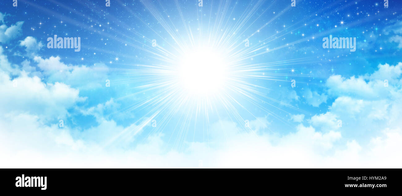 Shining sun breaking through white clouds in early morning blue sky, deep space and bright stars behind. - Stock Image