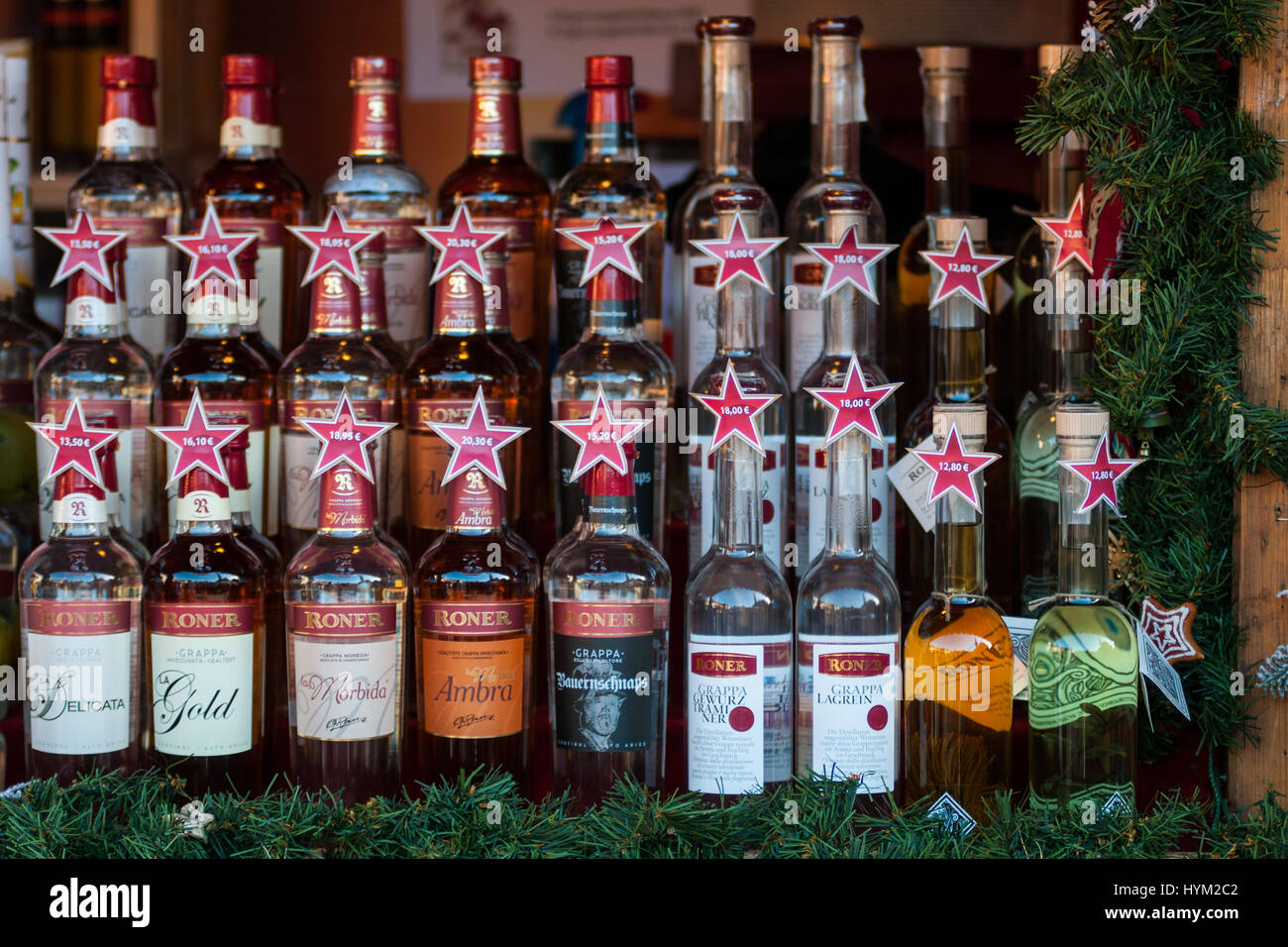 Spirits at the traditional Christmas markets of Bolzano, in Italy. - Stock Image
