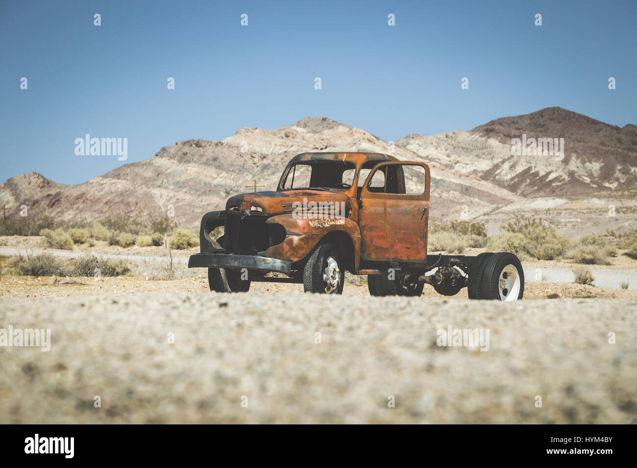 Classic view of an old rusty pickup truck car wreck in the desert ...