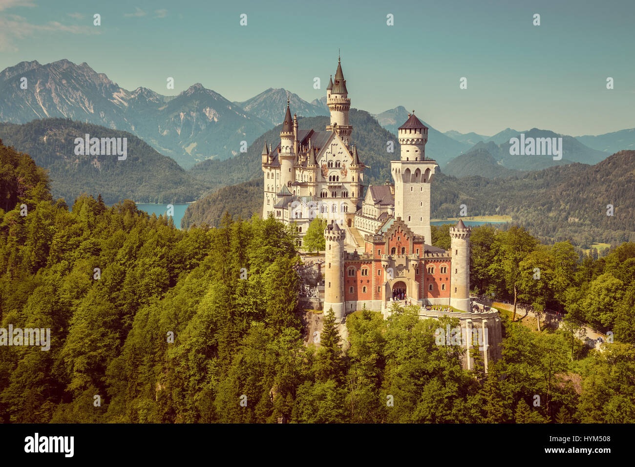Beautiful view of famous Neuschwanstein Castle, the 19th century Romanesque Revival palace built for King Ludwig - Stock Image