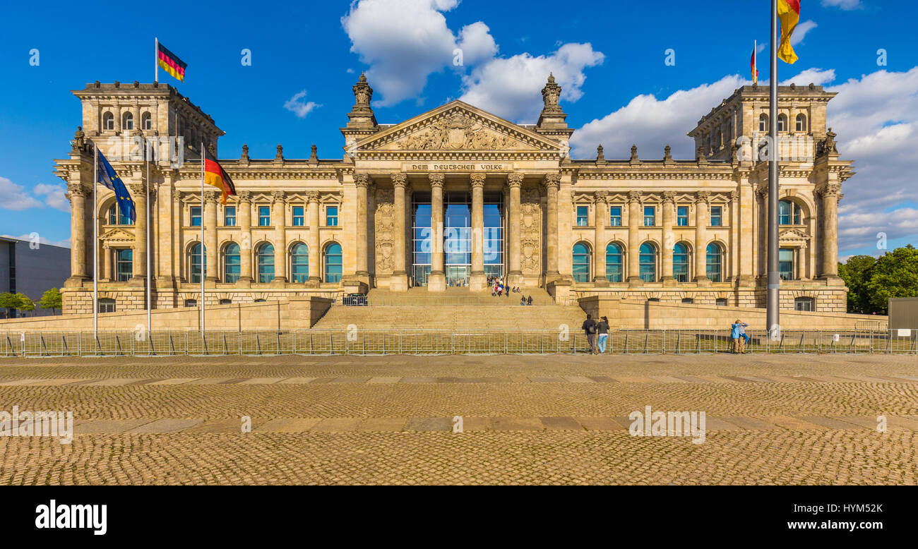 Panoramic view of famous Reichstag building, seat of the German Parliament (Deutscher Bundestag), in beautiful golden - Stock Image