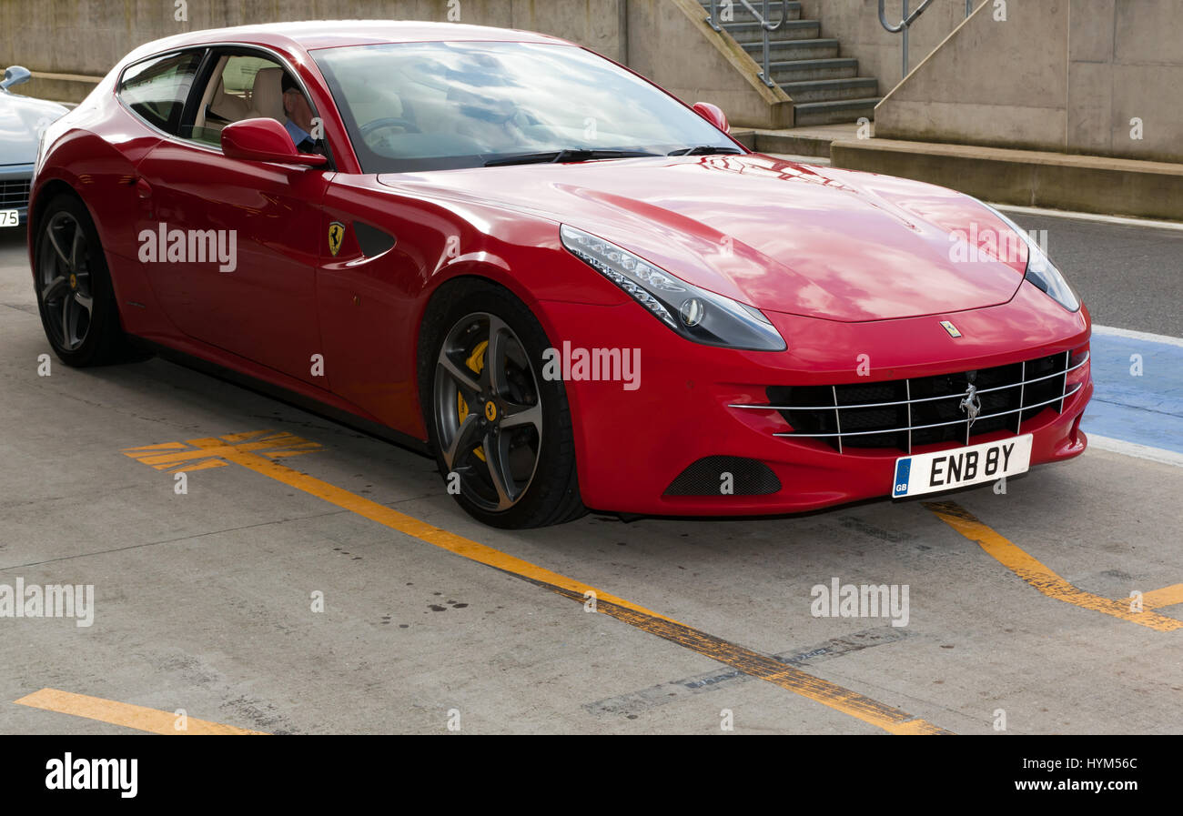 Three-quarter front view of a 2012,  Ferrari  FF, in the International Pit Lane  during the 2017 Silverstone Classic - Stock Image