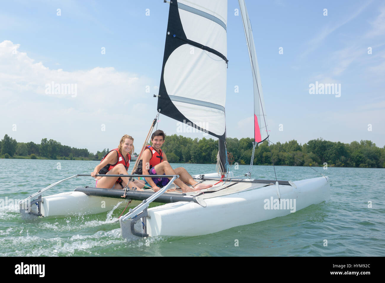 Couple on sailing vessel - Stock Image