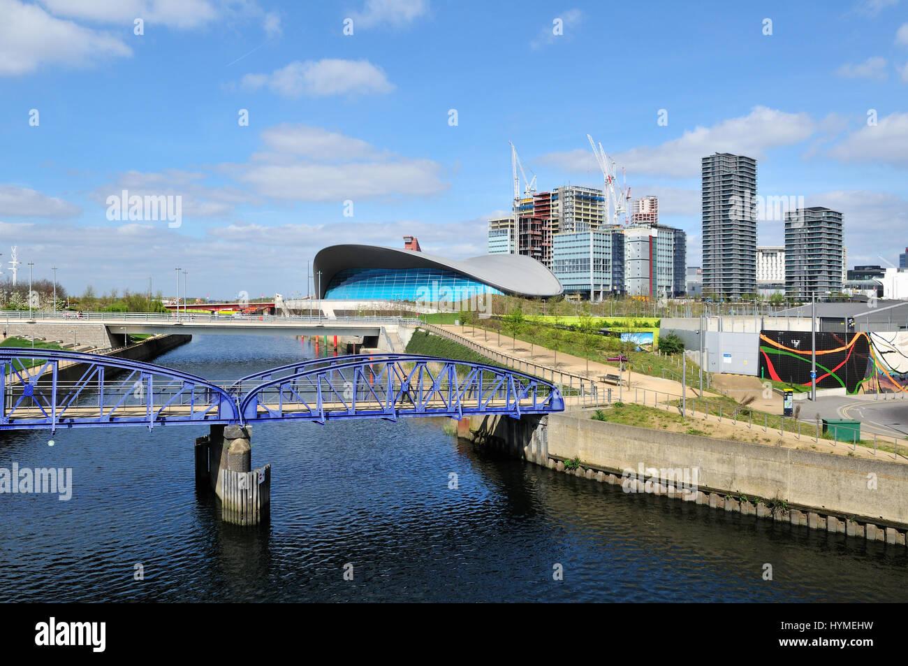 New buildings, new bridge and the London Aquatics Centre at Stratford, East London UK - Stock Image