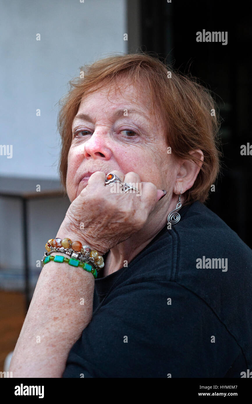 Attractive mature woman enjoying a relaxing moment at home age 74. Zawady Central Poland Europe - Stock Image