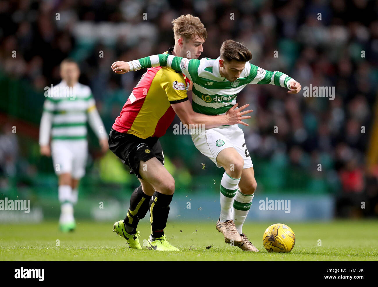 Celtic's Patrick Roberts and Partick Thistle's Liam Lindsay battle for the ball during the Ladbrokes Scottish - Stock Image