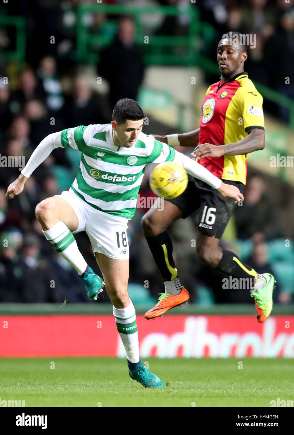 Celtic's Tom Rogic and Partick Thistle's Ade Azeez battle for the ball during the Ladbrokes Scottish Premiership - Stock Image