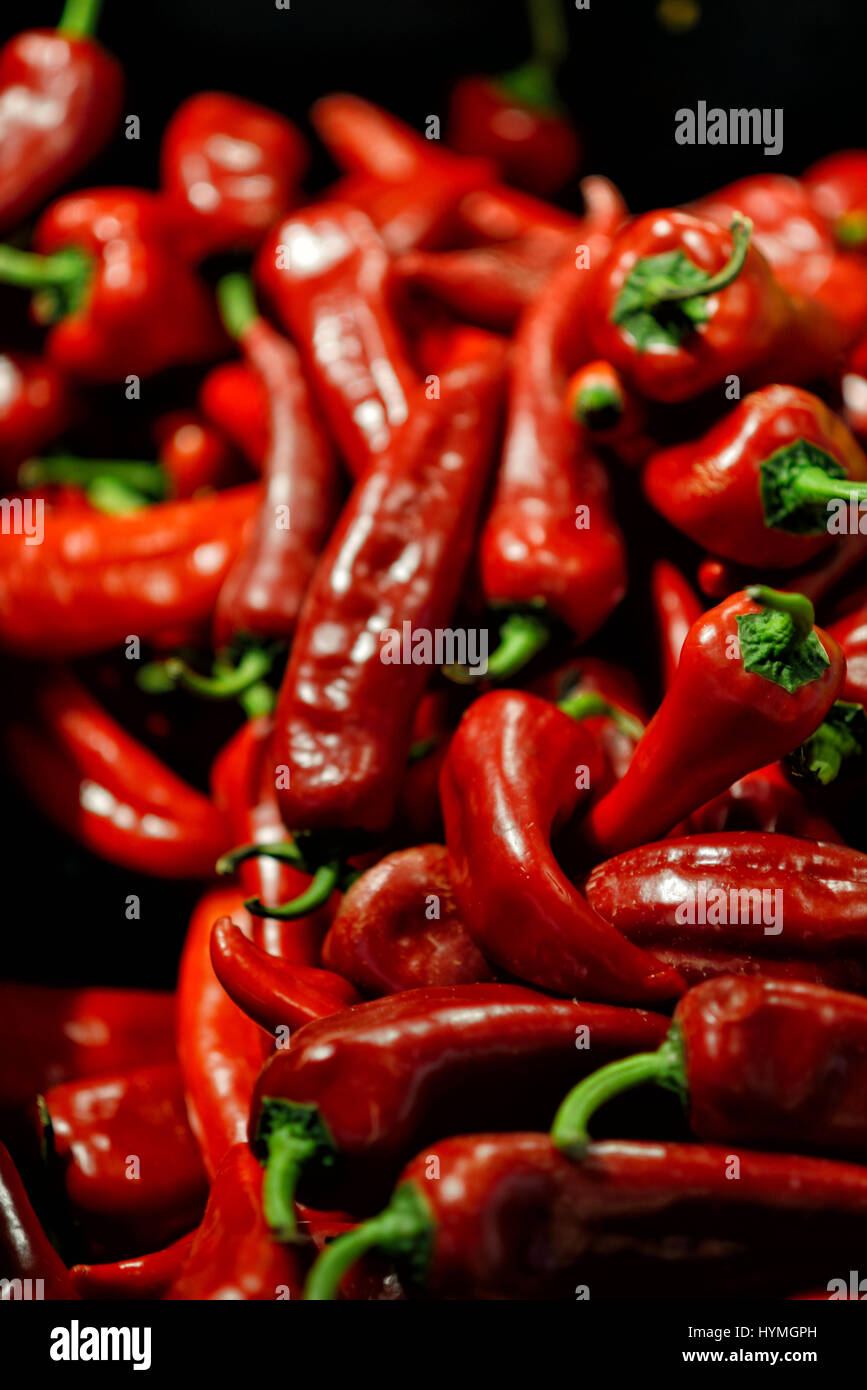 lot of red chilli peppers, background - Stock Image