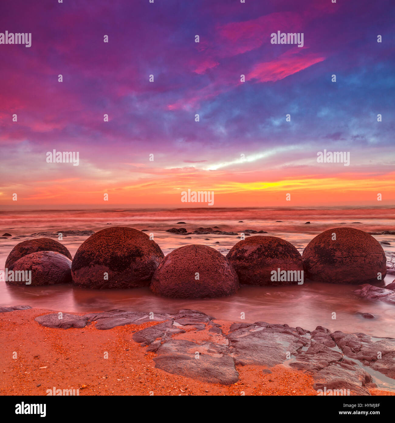 Moeraki Boulders, Otago, New Zealand - dramatic light at Moeraki Boulders, Otago, New Zealand. - Stock Image