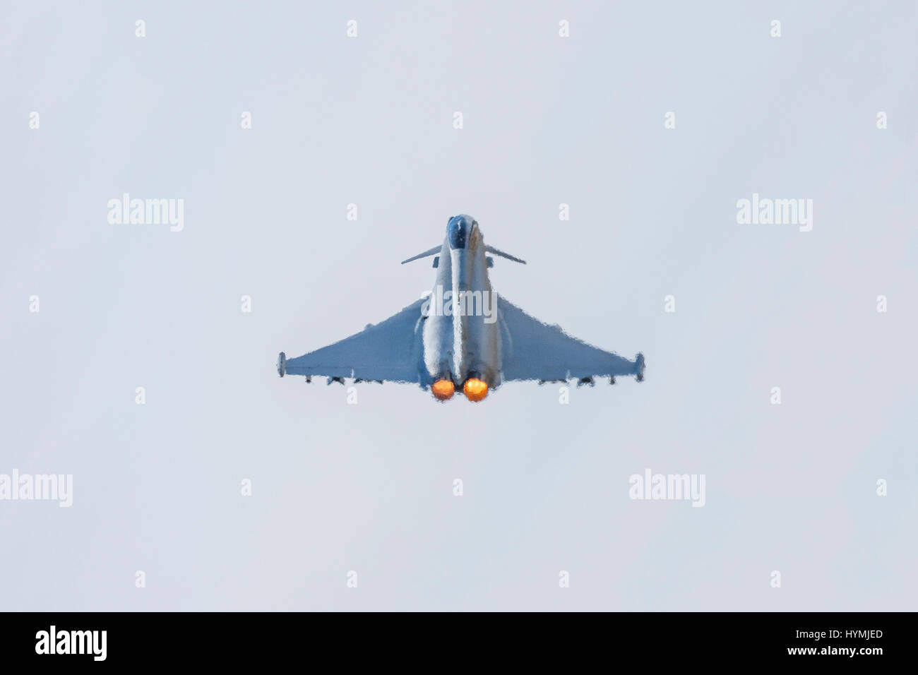 Eurofighter Typhoon jet fighter aircraft take off with afterburners, full reheat and heat haze Stock Photo