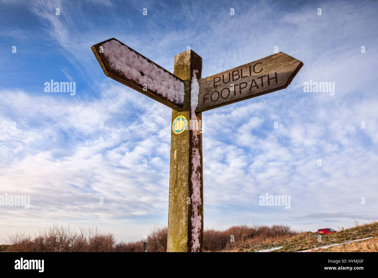 Public footpath sign with snow on it, at Flamborough Head, East Yorkshire, England, UK. - Stock Image