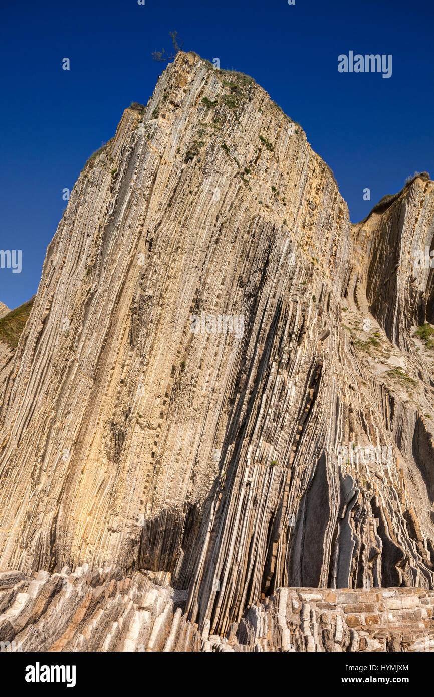 Flysch cliffs in the geological park at Itzurun Beach, Zumaia, Basque Country, Spain. - Stock Image