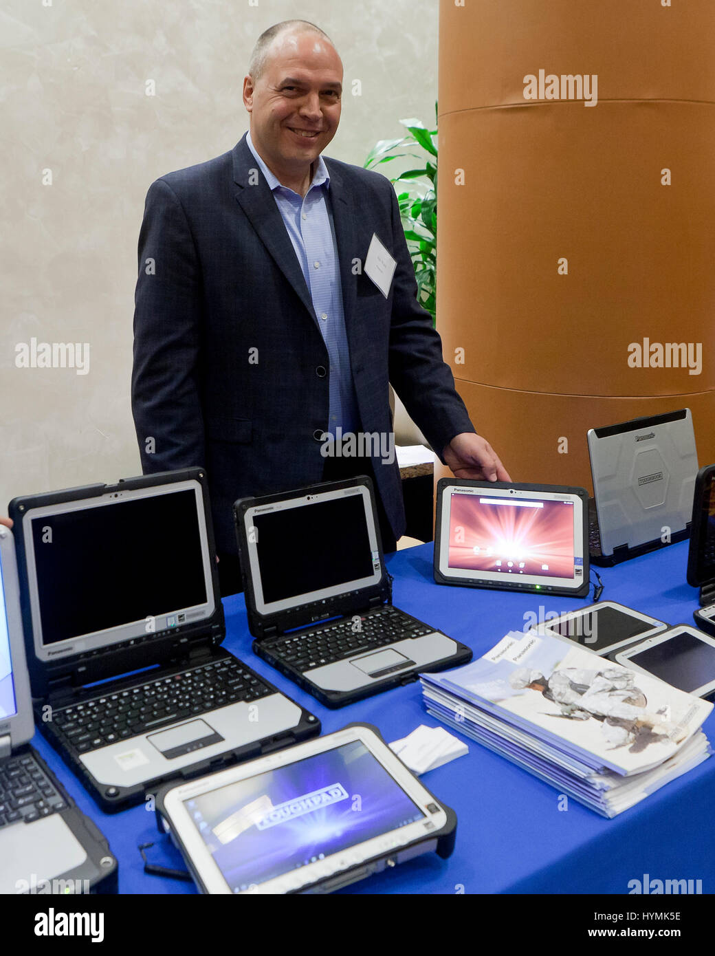 Man showing Panasonic rugged computer line - USA - Stock Image