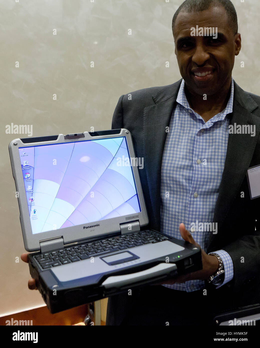 Man holding Panasonic Toughbook CF-31, rugged laptop computer - USA - Stock Image