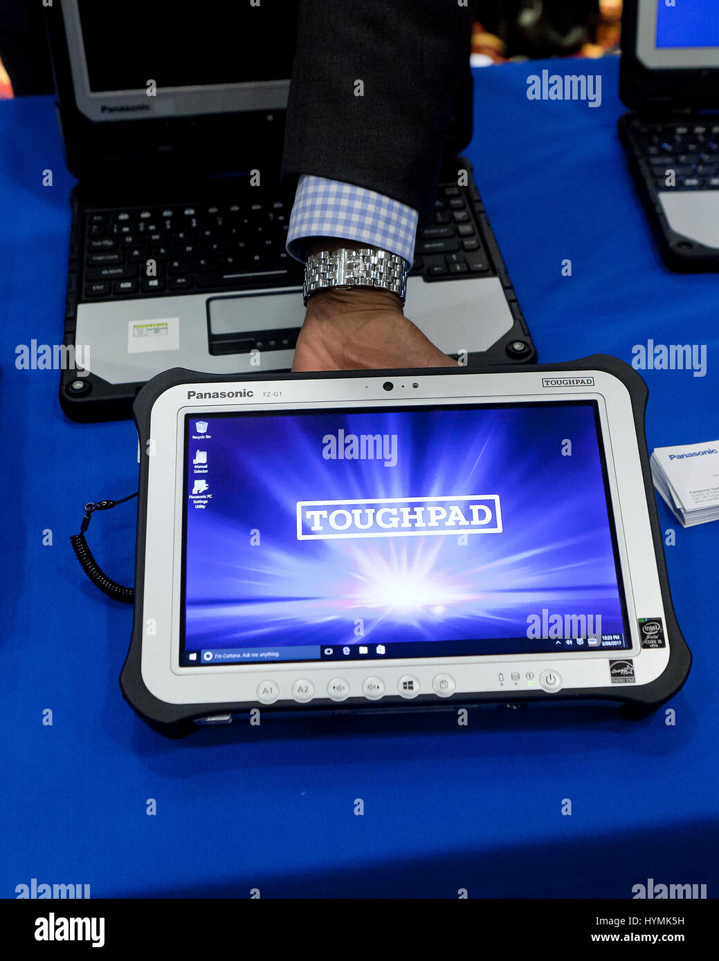 Man holding Panasonic Toughpad (rugged tablet PC) - USA - Stock Image
