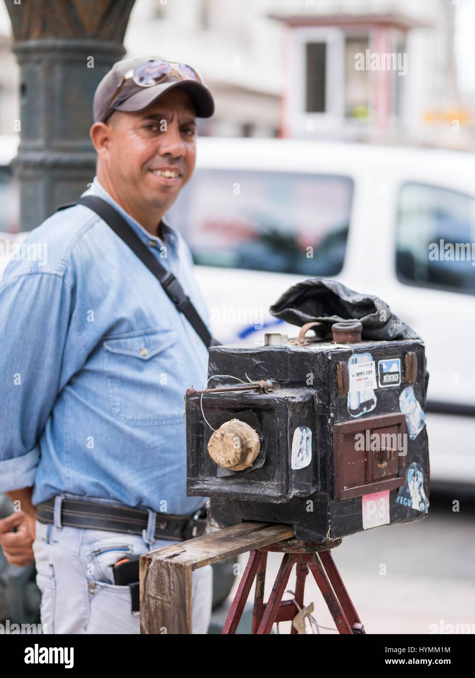 Cuban man posing in front of his handmade large format camera in Central Havana, Cuba - Stock Image