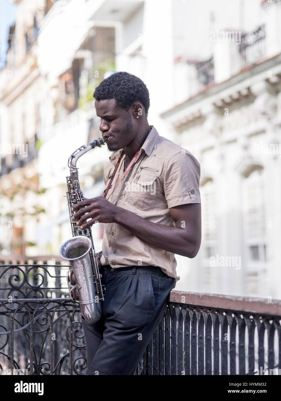 Cuban man playing saxophone in Old Havana, Cuba, West Indies, Central America - Stock Image