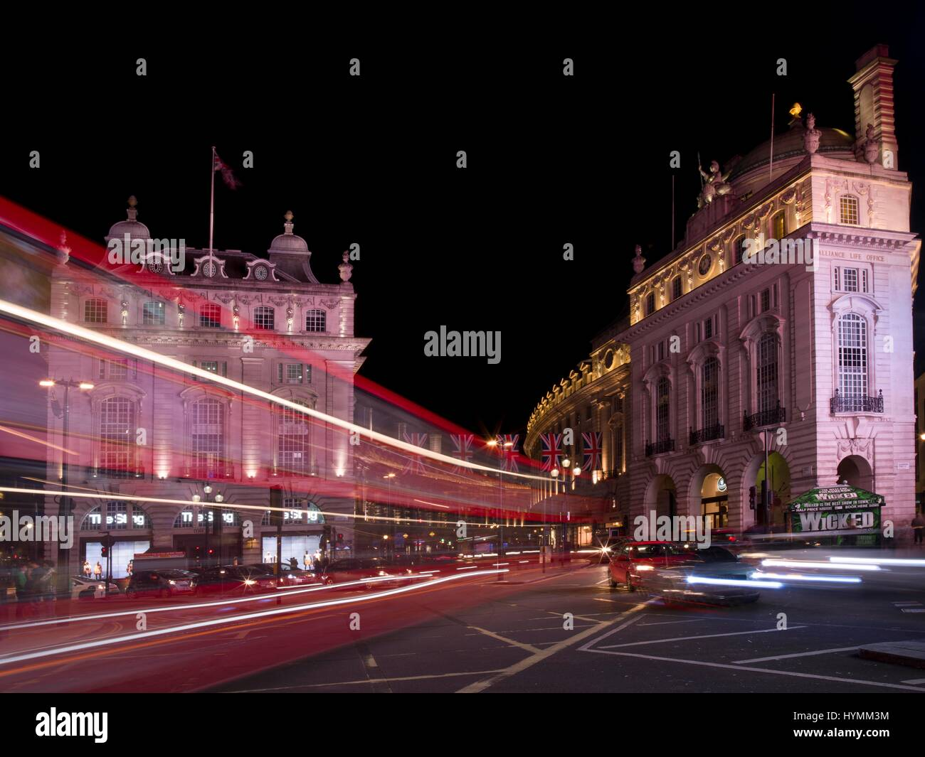 Road junction of Piccadilly Circus at nighttime in Central London, City of Westminister, England, United Kingdom - Stock Image