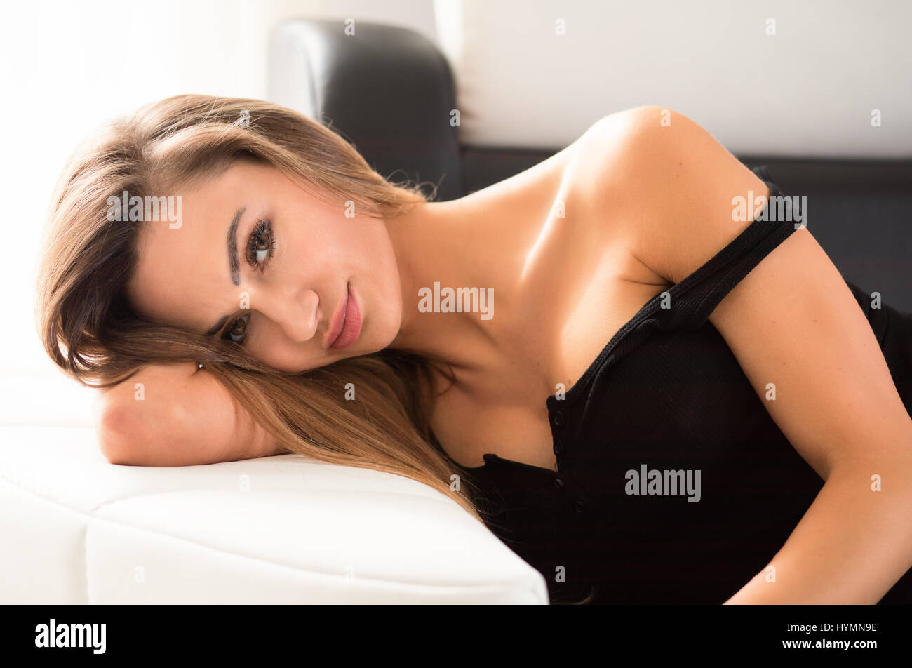 Young, fit and slim, beautiful woman with an expression on her face - joy, desire, reverie, pensiveness, thoughts. - Stock Image