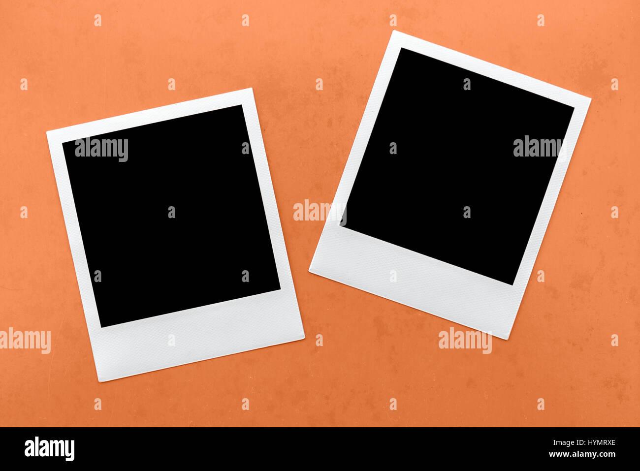 two blank instant camera film frames on orange background Stock ...