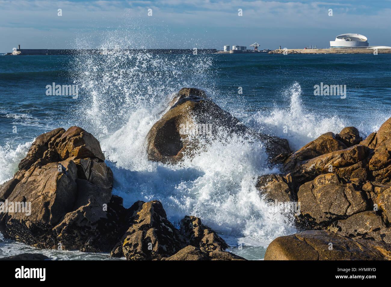 Waves smashing against rocks on the beach in Nevogilde civil parish of Porto, Portugal. Port of Leixoes Cruise Terminal Stock Photo