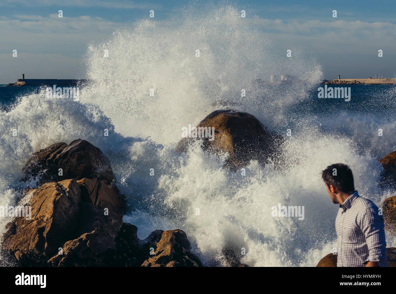 Big waves smashing on rocks of Atlantic Ocean shore in Nevogilde civil parish of Porto, second largest city in Portugal - Stock Image