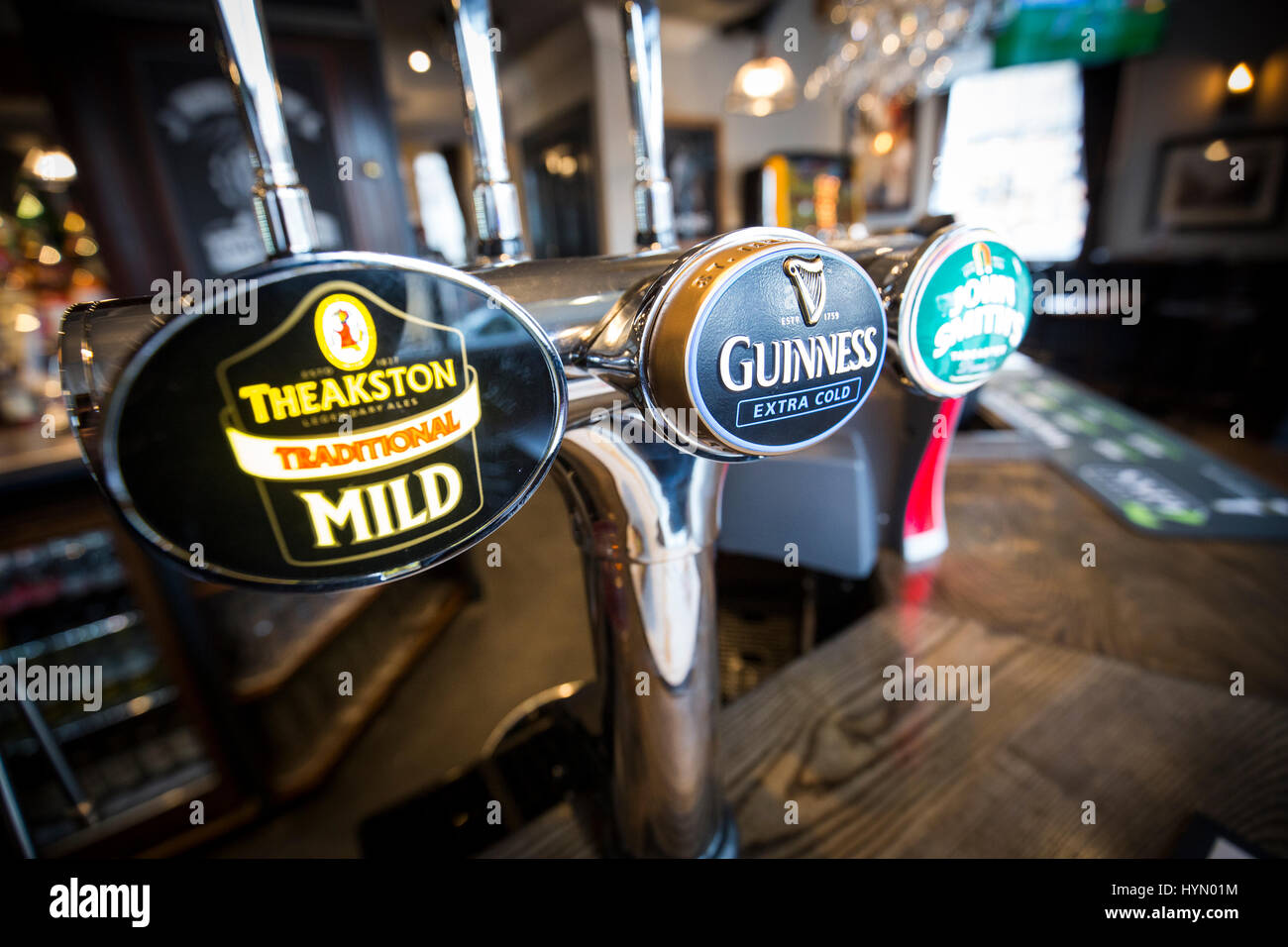 Drink taps in an English pub - Stock Image