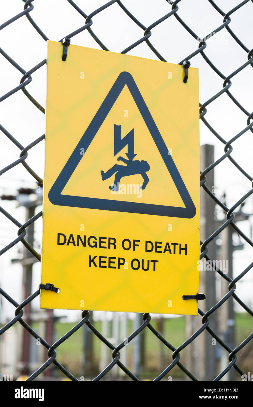 Danger of Death Keep Out yellow sign - Stock Image