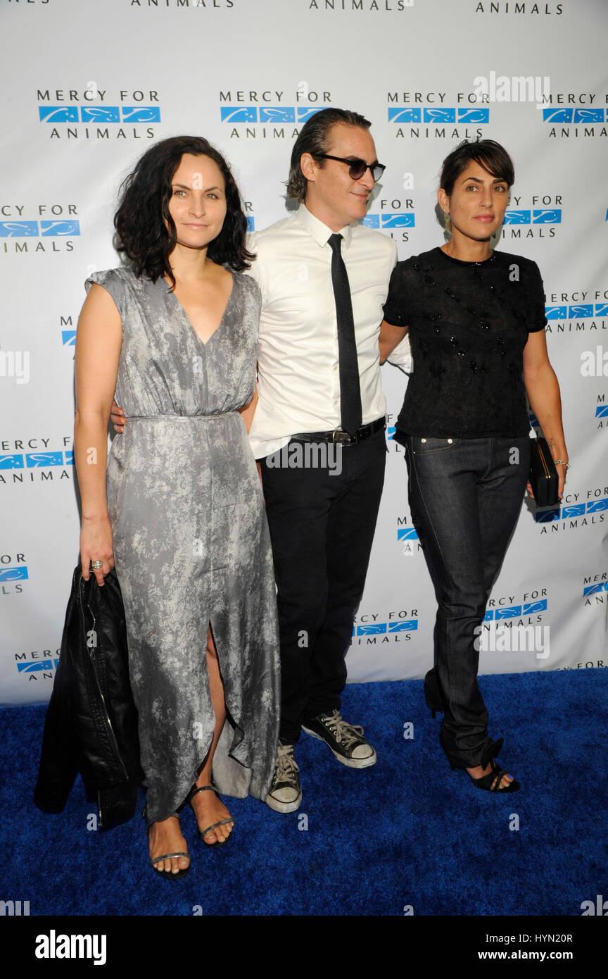 (L-R) Rain Phoenix, Joaquin Phoenix and Summer Phoenix attend the Mercy For Animals Hidden Heroes Gala at Unici - Stock Image