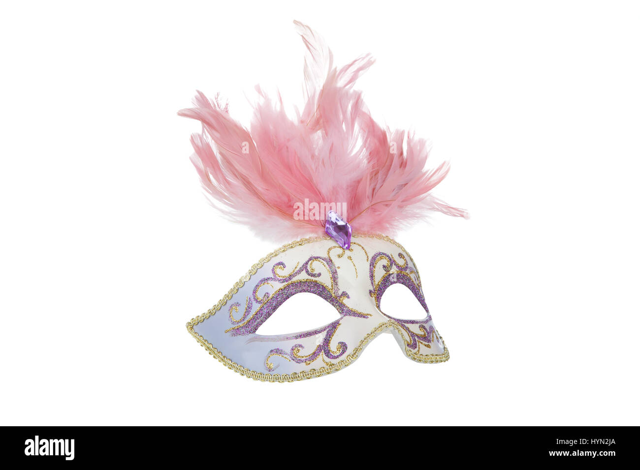 Beautiful carnival mask with pink feathers, isolated on white - Stock Image
