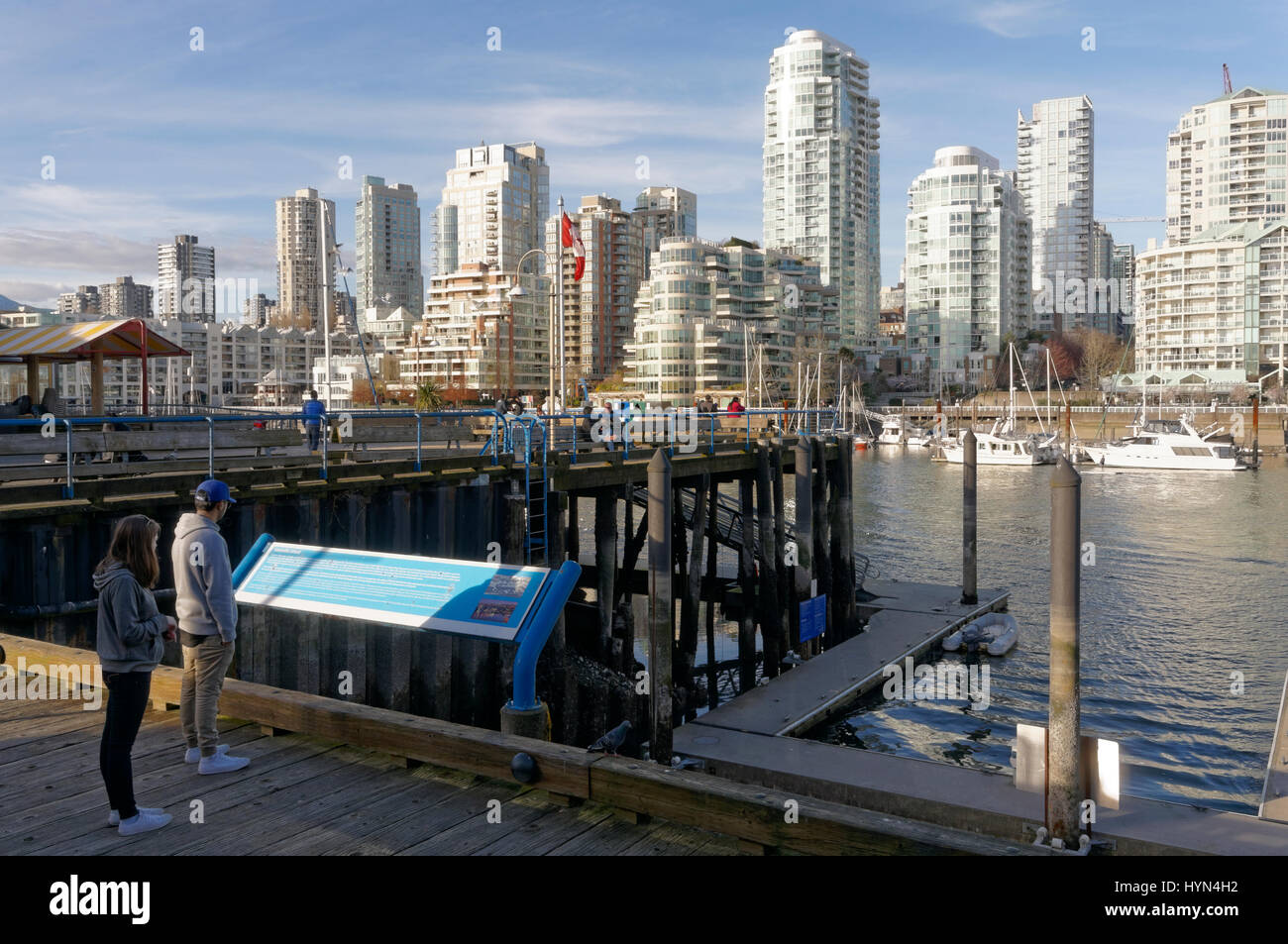 Granville island waterfront with False Creek and downtown condominium towers in back, Vancouver, British Columbia, - Stock Image