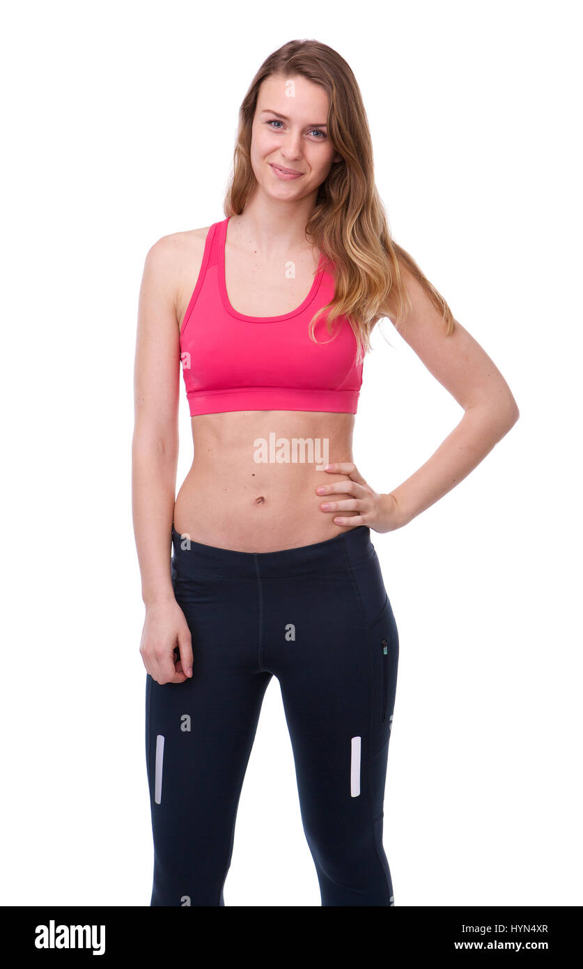 285369e55cf92 Portrait of a fit young woman in gym clothes posing on isolated white  background