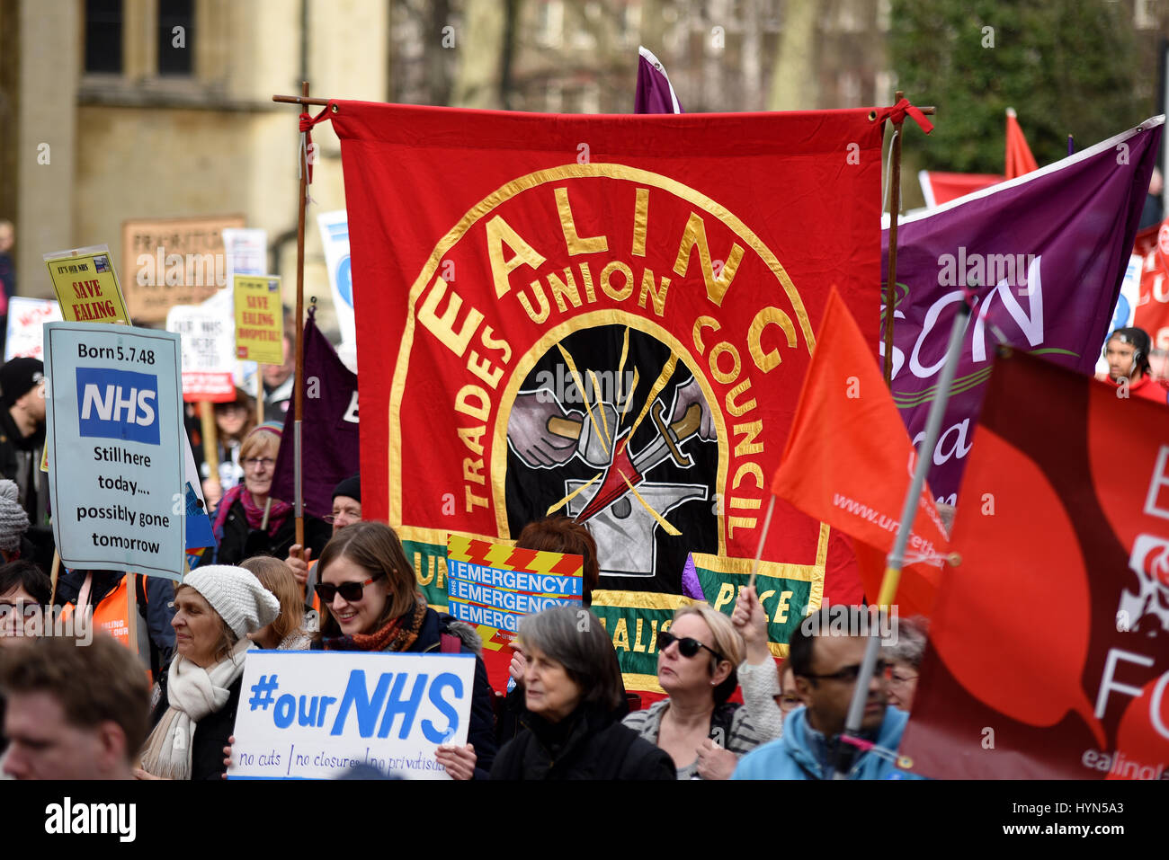 Ealing Trades Union Council banner during the 'Our NHS' support for the National Health Service demonstration - Stock Image