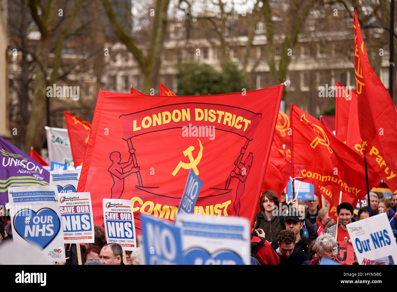 Communist Party flags during the 'Our NHS' support for the National Health Service demonstration on Parliament, - Stock Image