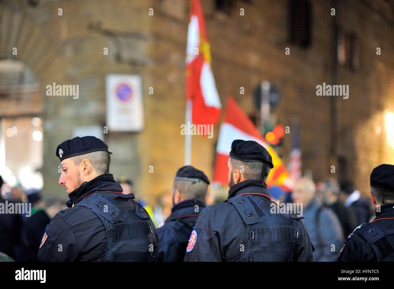 People manifesting against the increasing number of migrants and reduce jobs, in center of Florence, Italy, in novembe - Stock Image