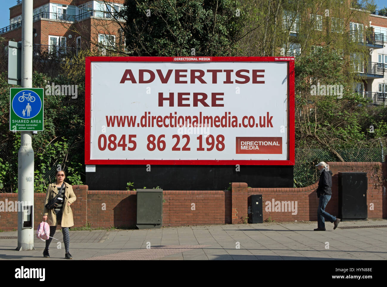 advertise here, billboard inviting advertisers to advertise, in kingston upon thames, surrey, england - Stock Image