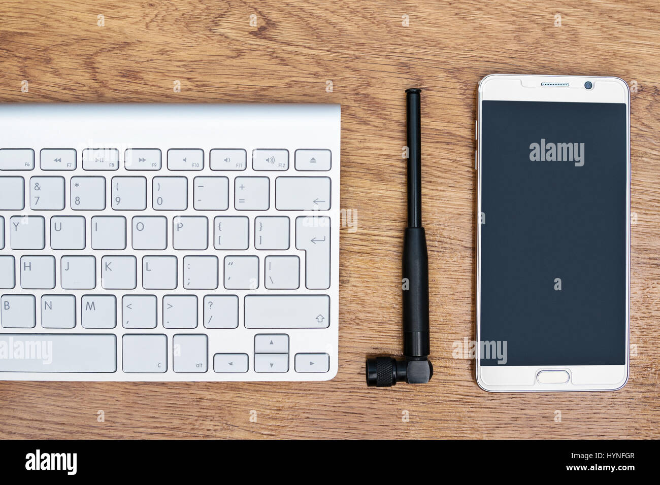 Telephone, antenna and keyboard on the table - Stock Image