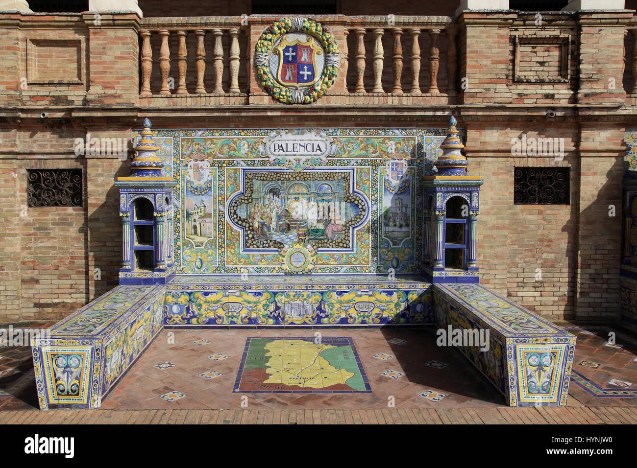 Ceramic Azulejos tiled provincial Bench or Alcove of Palencia on the Plaza de España in Parque de Maria Luisa - Stock Image
